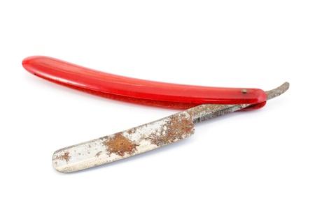 nicked: Vintage straight razor isolated on a white background  Stock Photo
