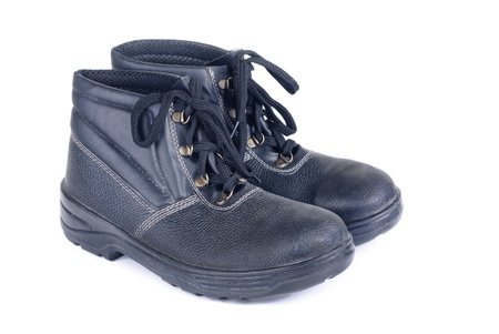 Working mans boots black isolated on a white photo