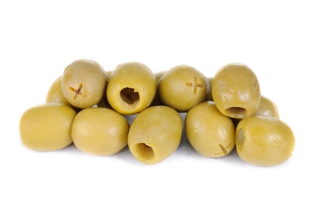 Some green pitted olives isolated on the white background