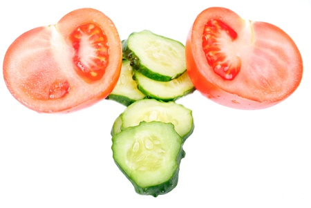 cucumber and  tomato sliced isolated on white background. Stock Photo - 9639833