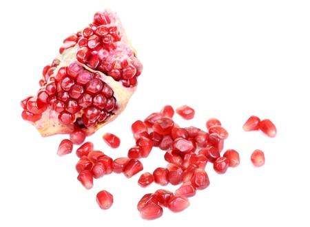 pomergranate: Pomergranate slice  and berry  isolated on white background