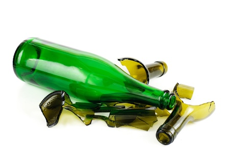 Whole and shattered green  bottle isolated on the white background