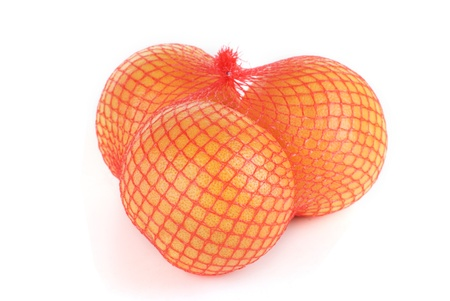 grapefruits in the grid isolated on white Stock Photo - 10026190