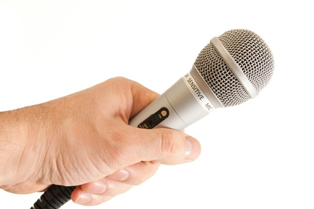 narrate: 3  download  Shutterstock !!!Microphone in a hand on a white background Stock Photo