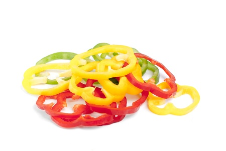 red, green and  yellow sliced pepper isolated on white background