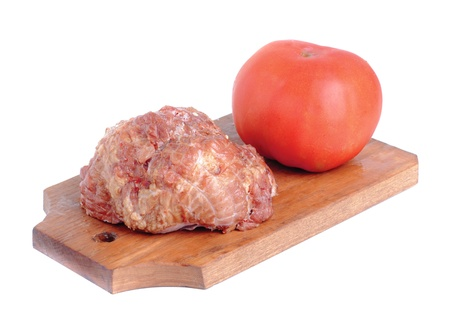 Meat product.and tomato   on a cutting board on white Stock Photo - 10674063