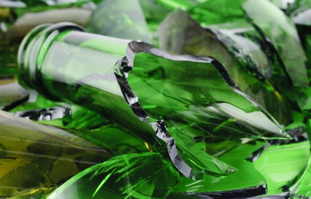 Waste glass.Recicled.Shattered green wine bottle  photo