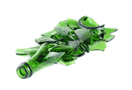 vandal: Shattered green champagne bottle isolated on the white background  Stock Photo