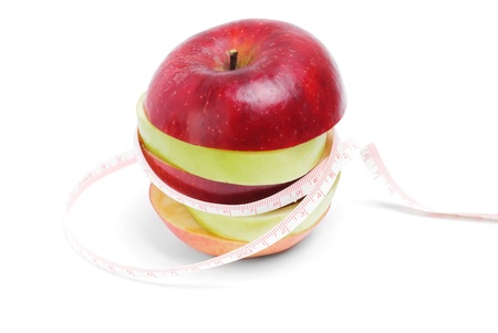 pome: Healthy eating and diet concept:Green and red sliced apple with tape on white background