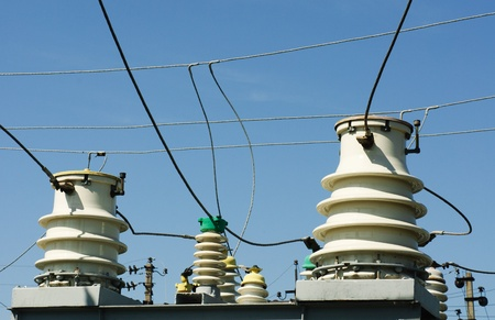 isolator insulator: part of high-voltage substation  on the  blue  sky background