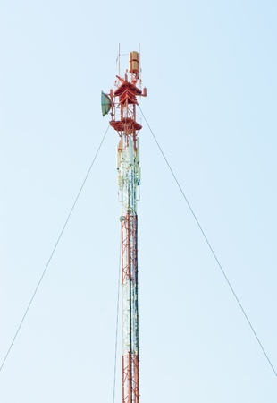 Telecommunications tower with different antenna  on blue sky background Stock Photo - 13578694