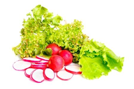 fresh salad , whole and  sliced radish  isolated on white