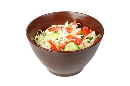 fresh salad with tomato, cabbage and cucumber on bowl isolated on white  photo