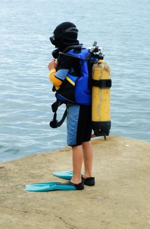 Little scuba diver , before diving into  sea Stock Photo