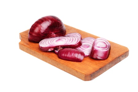 aftertaste: sliced purple onions on cutting board isolated on white