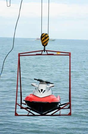 jet ski lift for dry storage   on the sea  background photo