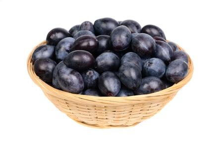 fruit basket: fresh blue plums in Fruit Basket  on the white background
