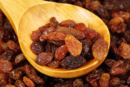 raisins and  wooden  spoon close- up food background  photo