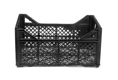 Black plastic crate isolated on white background photo