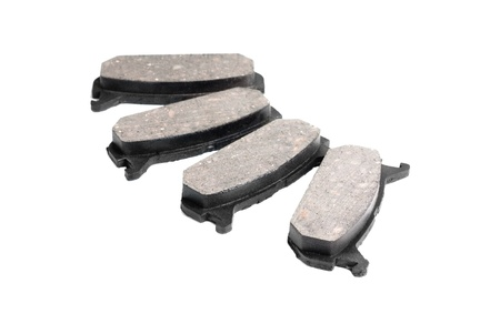 four brake pads, isolatet on white  photo
