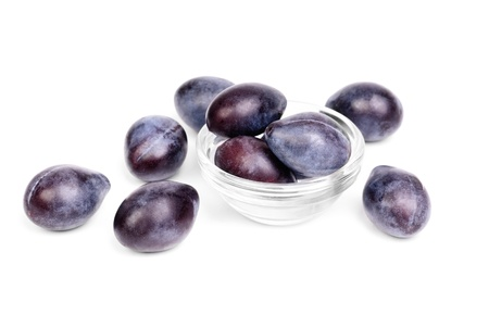 Some fresh blue plums on the white background photo