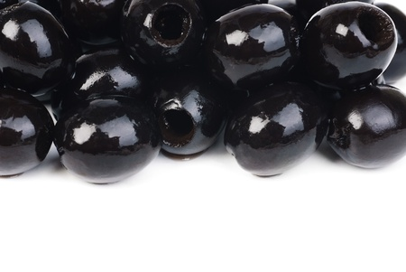 Black pitted olives isolated on white  photo