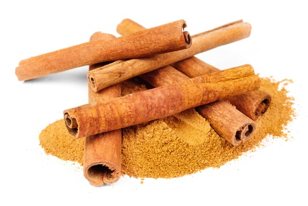 cinnimon: Cinnamon - sticks and powder  isolated on white