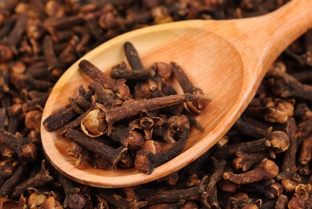 Cloves  spice  and wooden spoon close-up food background