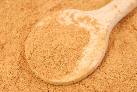 cinnimon: Cinnamon  powder and wooden spoon as  nature  food   background