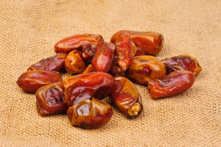 deglet: dried dates on canvas background Stock Photo