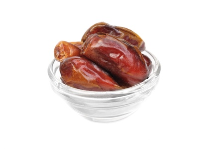 deglet: dried dates on glass bowl isolated on white background Stock Photo