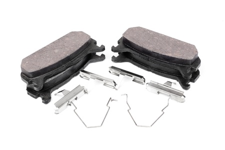 four brake pads and spring, isolatet on white  photo