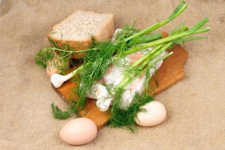 Eggs,lard garlic, dill  on  burlap background