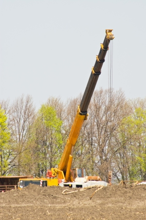 crane working on the oil and gas fields photo