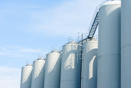 brewery tanks blue sky big containers beer production industry Stock Photo - 21072965
