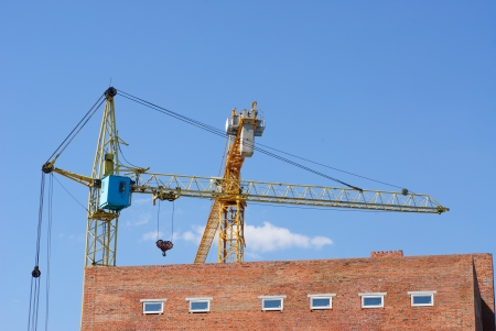 Tower cranes on blue sky  background photo
