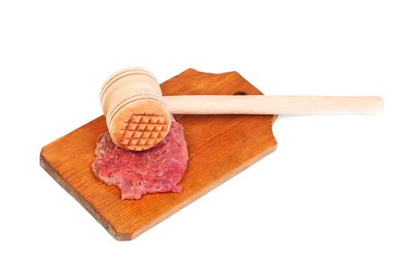 a wooden hammer for beating the meat and meat