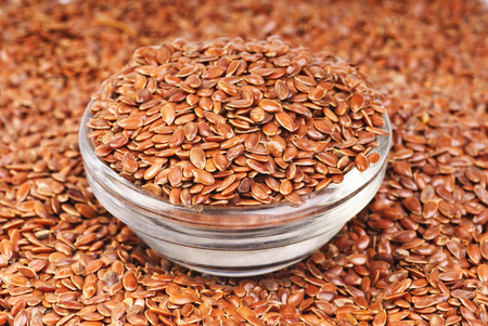 close up of flax seeds and bowl food background  photo