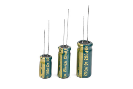 electrolytic: Electrolytic Capacitors in green isolated on white Stock Photo