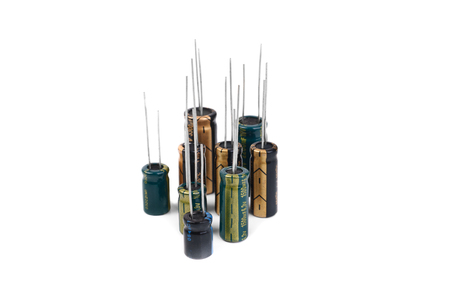 electrolytic: Electrolytic Capacitors green,black,yellow isolated on white Stock Photo