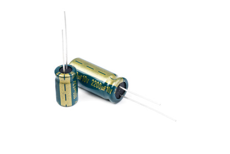 electrolytic: Two electrolytic capacitor in green isolated on white