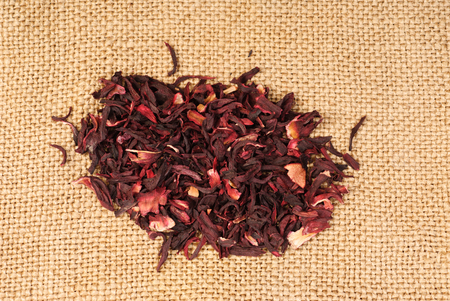 nontraditional: Hibiscus tea dry flower on sackcloth background