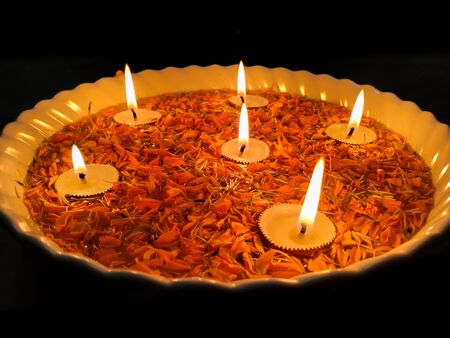 Happy Diwali, Tea light Candle Diya With Marigold Flower Floating in Water Inside Large Bowl