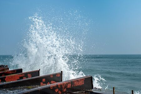 Ocean water splash near the broken boat at Chilika Lake, Odisha, India 免版税图像