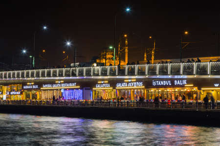 city fish market: Night view of the Galata Bridge karakoy in Istanbul. The bridge spans the Golden Horn and has two levels. At the bottom level are restaurants and cafes.