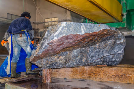 sharply: Workers are working, cutting marble cutter Stock Photo