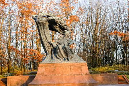 Fryderyk Chopin monument in autumn scenery of the Royal Lazienki Park in Warsaw, Poland, designed around 1904 by Waclaw Szymanowski (1859-1930). November 8, 2016: Warsaw, Poland Editorial