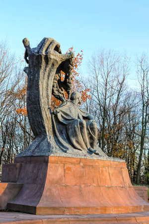 Chopin statue in autumn at Royal Baths Park (Lazienki Park) in Warsaw, Poland, designed around 1904 by Waclaw Szymanowski (1859-1930). November 8, 2016: Warsaw, Poland Editorial