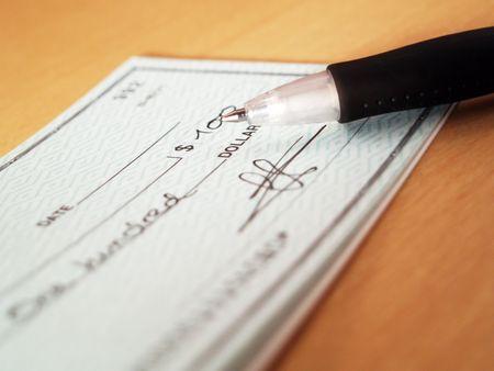 Signing a check photo