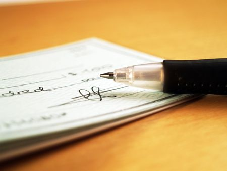 owe: Writing a check Stock Photo